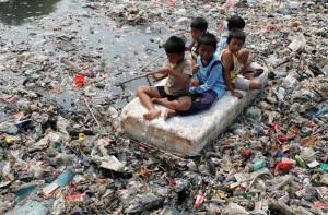 children in dirty water